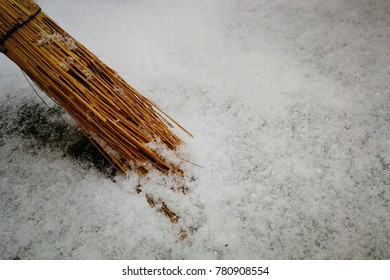 snow. snow cleaning. broom in the snow