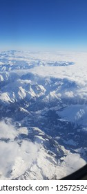 Snow and cloud covered mountains alps