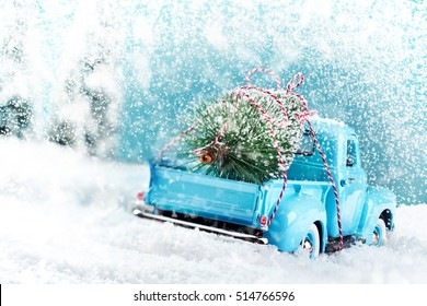 Snow countryside with christmas tree truck driving home