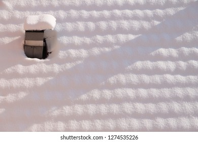 Snow cover and chimney on rooftop