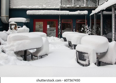 snow cover the outside tables