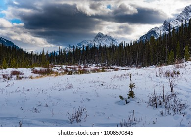 Snow cover winter moutain scenery. Snowshoeing in Kananaskis Country Alberta Canad