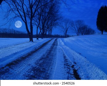 Snow coverd rural lane at night in moon light.