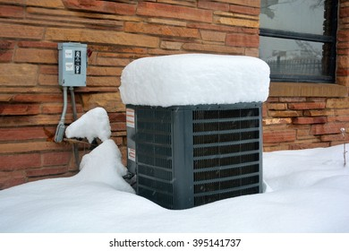 Snow Covered Air Conditioner on a Cold Winter Day