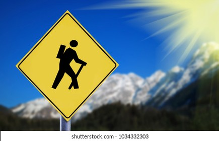 Snow covered Alps with hiker symbol on yellow traffic road label