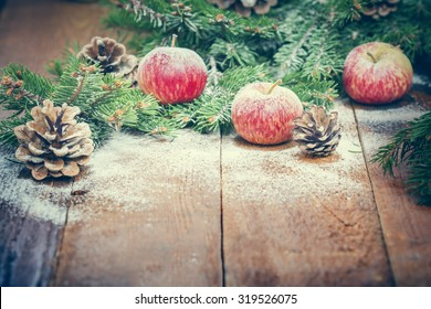 snow covered apples on the board. Winter composition . Pleasant toned photo . New Year card