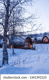 Snow covered cabin (Gabba) in the woods designed after the indigenous Sami peoples lavvu (tent). Kirkenes, Norway
