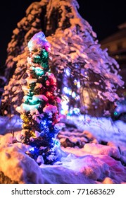 Snow Covered Christmas Tree with multicolored lights