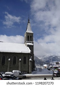 Snow covered church steeple in alpine village of  Chatel, France