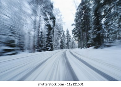 Snow covered country road from below in motion blur