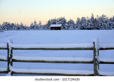 Snow Covered Fence line and Pasture Barn Dawn