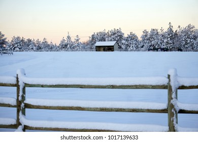 Snow Covered Fence line and Pasture Barn
