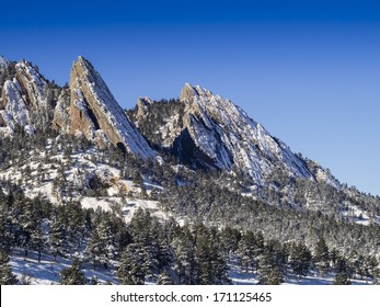 Snow covered Flatiron Peaks in Boulder Colorado