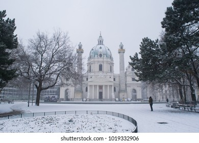Snow covered grounds in front of Karlskirche in the city of Vienna, Austria
