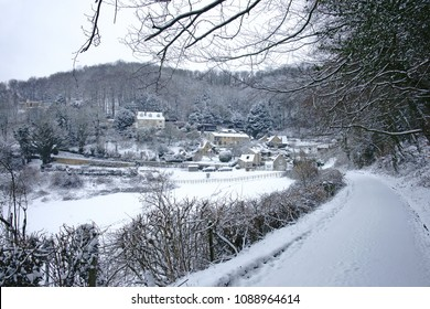 The snow covered highway into the small hamlet of Elcombe after an over night snow storm, The Cotswolds, Gloucestershire, UK