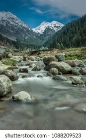 Snow Covered Himalayan Mountains and Waterfall in Aru Valley Pahalgam Jammu and Kashmir, India