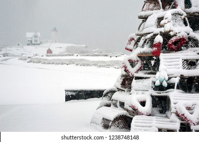Snow covered holiday lobster trap tree near Nubble lighthouse to honor those fishermen that make a living along the seacoast. This is a New England tradition for many coastal communities.