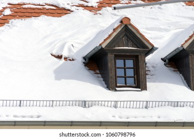 snow covered house roof