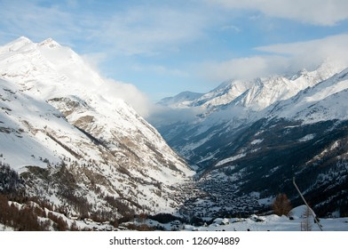 Snow covered houses in Zermatt, ski resort