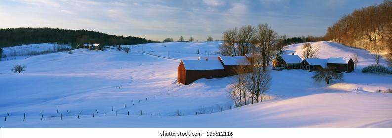 Snow covered Jenne Farm at sunrise.