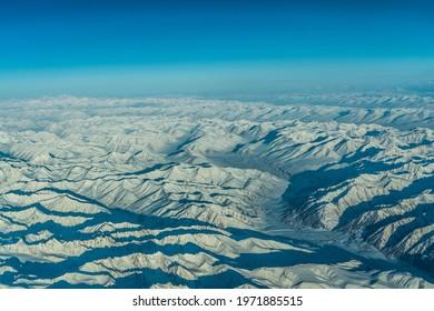 snow covered Karakorum mountain range between China, India and Pakistan, aerial view