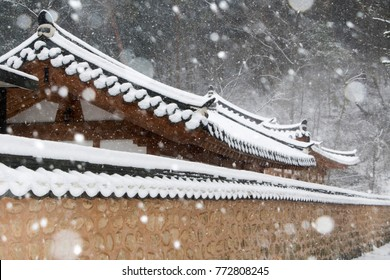 Snow covered Korean traditional stone wall and roof tile