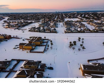 snow covered landscape above Austin Texas after winter storm Uri during morning sunrise over suburb homes
