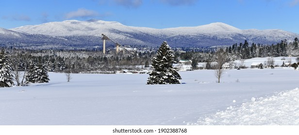 Snow covered landscape with Ski Jumps in background, Lake Placid New York  - Shutterstock ID 1902388768