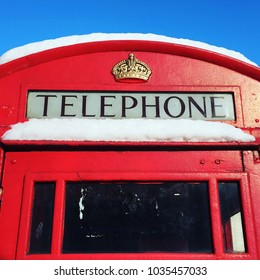 Snow covered London red phone box beast from the east
