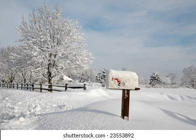 Snow covered mailbox against a cold New England landscape