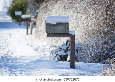 Snow Covered Mailbox. Winter snow caps a mailbox along a country road on Lummi Island   in the San Juan Islands of Puget Sound.