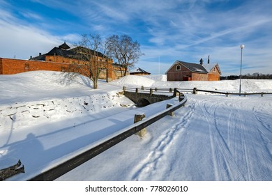 Snow covered medieval castle in the city of Hameenlinna, Finland at sunny winter day