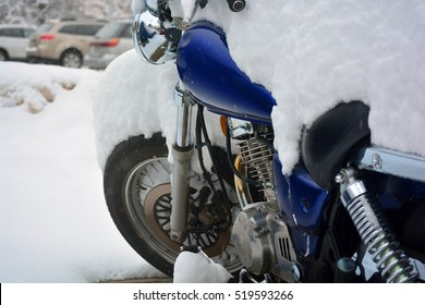 Snow Covered Motorcycle on a Cold Winter Day