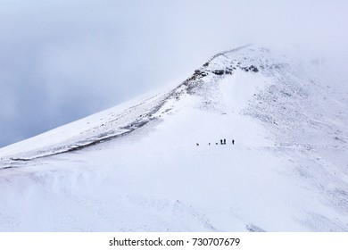 Snow covered mountain landscape of Pen y Fan Mountain in the Brecon Beacons National Park, Wales, UK.