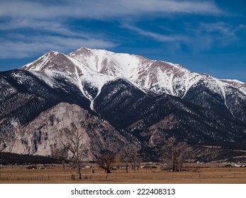 snow covered mountain peak rising above valley. Mt Princeton, Buena Vista, Colorado