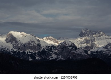 SNow covered mountain range. Triglav under clouds. Julian Alps,