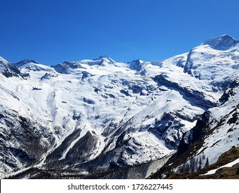 Snow Covered Mountain Scene in the Ski Area of Saas-Fee, Valais, Switzerland, Europe on a Sunny Spring Day