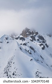 Snow covered mountain top with clouds in Austria. It's amazing how fast the weather changes in the mountains.