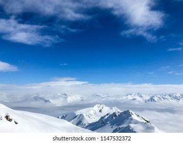 Snow covered mountains against sky
