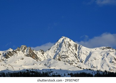 Snow covered mountains with a blue sky