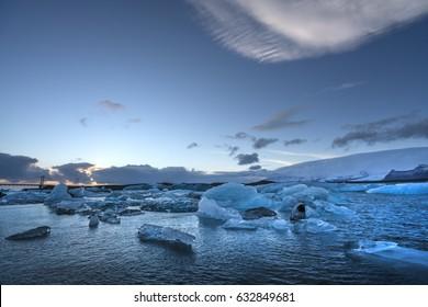Snow covered mountains glacier iceberg horizon blue ocean
