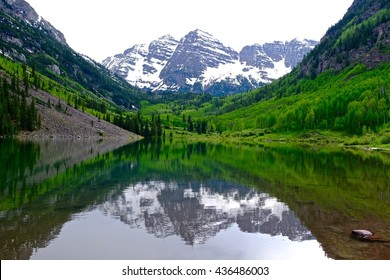Snow Covered Mountains, Green Trees, Lake and Reflection.  Maroon Bells near Aspen, Colorado State, USA.
