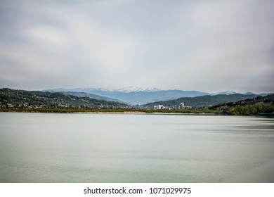Snow covered mountains with a lake in the foreground