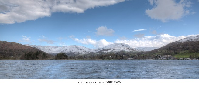 Snow covered mountains from lake windermere