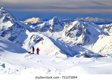 Snow covered mountains and off piste skiers near Les Deux Alpes, France