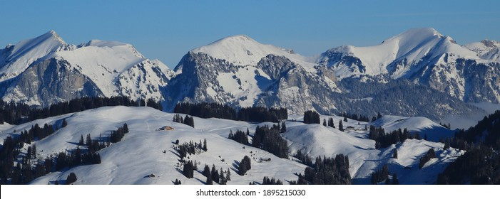 Snow covered mountains Schafberg and Kaiseregg.