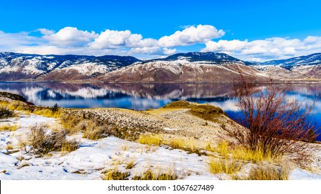 Snow Covered Mountains surrounding Kamloops Lake in central British Columbia, Canada on a cold and crisp Winter Day under a blue sky