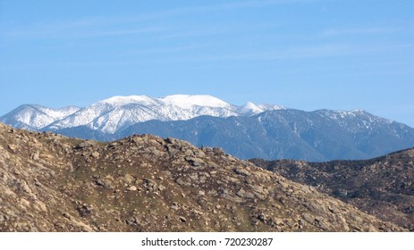 Snow covered mountains towering above the desert, California