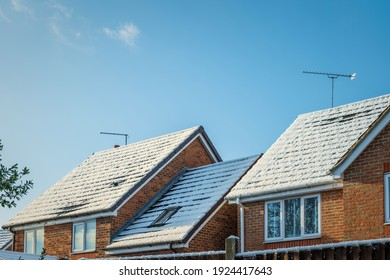 Snow covered new built house roof in england uk.