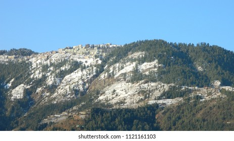 Snow covered peaks and hills in Shimla District of Himachal Pradesh India. A scenic view of Shali Tibba, Mashobra and Kufri in winter.